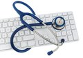 Stethoscope and keyboard of a computer symbol photo for diagnosis appointment management Royalty Free Stock Images