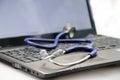 Stethoscope on laptop Royalty Free Stock Photo