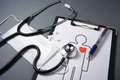 Stethoscope, mask, medicines, medical record and pen. Stock Photos