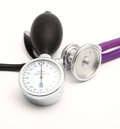 Stethoscope measurement of pressure and isolated on white background Royalty Free Stock Photos