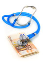 Stethoscope and money blue is over euro Royalty Free Stock Photography