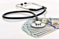 Stethoscope and money Royalty Free Stock Photo