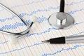 Stethoscope and pen on ecg Royalty Free Stock Photo