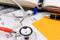 Stethoscope, pen and paper note on calendar, doctor appointment. Royalty Free Stock Photo