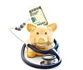 Stethoscope, piggy bank and banknotes 2 Royalty Free Stock Image
