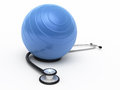 Stethoscope and pilates ball Royalty Free Stock Image