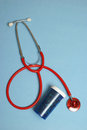 Stethoscope pill bottle to remedy many medical treatments patient Stock Photo