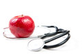Stethoscope and a red apple Stock Photos
