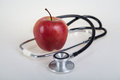 Stethoscope and red apple healty food medical Royalty Free Stock Images