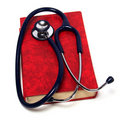 Stethoscope on red book Royalty Free Stock Photography