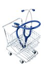 Stethoscope and shopping cart Royalty Free Stock Photo
