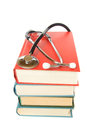 Stethoscope and stack of books close up isolated on white background medical professional education information concept Stock Photo