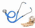Stethoscope with tablets  . Herbal supplements Royalty Free Stock Photo