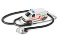 Stethoscope and toy ambulance car isolated on white background Royalty Free Stock Photos