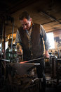 Steven bronstein blacksmith forges owl beak vermont black smith removing a piece of red hot metal from the forge is a well known Royalty Free Stock Photography