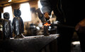 Steven bronstein blacksmith forges owl beak vermont black smith working a piece of metal in his marshfield vermont studio to Stock Images