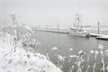 Steveston dock winter snow a lone fishboat tied to the waiting out a snowstorm british columbia canada Royalty Free Stock Image