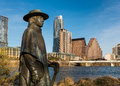 Stevie ray vaughan statue in front of downtown austin and the colorado river from auditorium shores in austin texas Stock Photography
