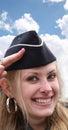 Stewardess smiling under cloudy sky Royalty Free Stock Photos