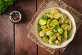 Stewed Brussels cabbage sprouts, apples and leeks in bowl. Royalty Free Stock Photo