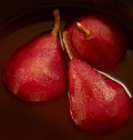 Stewed pears in red wine three a pot with Stock Photo