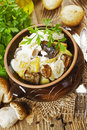 Stewed potatoes with mushrooms and sour cream Royalty Free Stock Photo