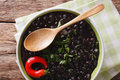 Stewed spicy black beans close up in a bowl. Horizontal top view Royalty Free Stock Photo