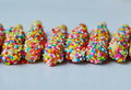 Stick bread dressing  cream and colorful candy Royalty Free Stock Photo