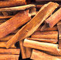 Stick cinnamon close up background of dried a spice obtained from the inner bark of several trees from the genus cinnamomum used Royalty Free Stock Image