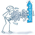 Stick figure with boost the success with gears and business concept Royalty Free Stock Photo