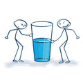 Stick figure with the glass is half full or half empty Royalty Free Stock Photo