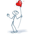 Stick figures with a heart on a stick Royalty Free Stock Photo