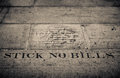 Stick no bills sign post on the wall of a court building Stock Photo