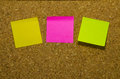 Stick note colours on cork board background Stock Photo