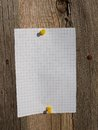 Sticker on wall blank paper sheet old wooden barn doors Stock Photo