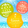 Stickers with summer vacation and travel emblems on a glass against a sunny seascape Stock Photos