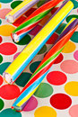 Sticks of candy four colorful rock on a colorful dotted background Stock Image
