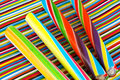 Sticks of candy four colorful rock on a colorful striped background Stock Photography