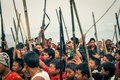 Sticks and rifles wanching nagaland april crowd of native people hold wooden at traditional aoleang festival in wanching nagaland Stock Images
