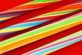 Sticks of rock four colorful candy on a red felt background Royalty Free Stock Photography