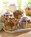 Sticky buns and glazed cinnamon rolls a tray full of freshly iced Royalty Free Stock Photo