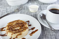 Sticky chocolate sauce on a freshly toasted crumpet with coffee Royalty Free Stock Photo