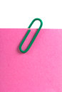 Sticky note and paper clip top view of pink with green isolated on white background Stock Photography