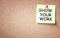 Sticky note pined to cork board with the phrase show your work written on i it room for text Royalty Free Stock Images