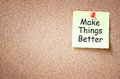 Sticky note pinned to cork board with the phrase make things better written on it room for text