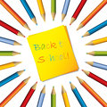 Sticky note with surrounding color pencils Royalty Free Stock Photography