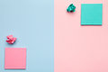 Sticky Notes with Crumbled Paper Balls on Pastel Background Royalty Free Stock Photo