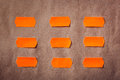Sticky orange notes on white old paper Royalty Free Stock Photography