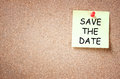 Sticky pinned to cork board with the phrase save the date. room for text