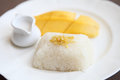 Sticky rice with mango on wood background Royalty Free Stock Image
